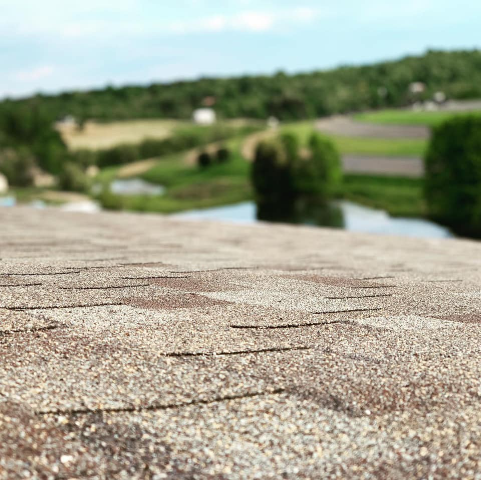 Brown shingle roof with a shingle surface upclose view